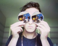 We don't have a photo of incident, so here's a picture of RL Grime with sea containers for eyes.