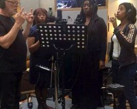 Pink Floyd's Dave Gilmour with Durga McBroom-Hudson (second from right) and backing vocalists in the studio