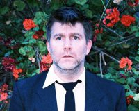 LCD SOUNDSYSTEM'S James Murphy serves it up to Margaret Court